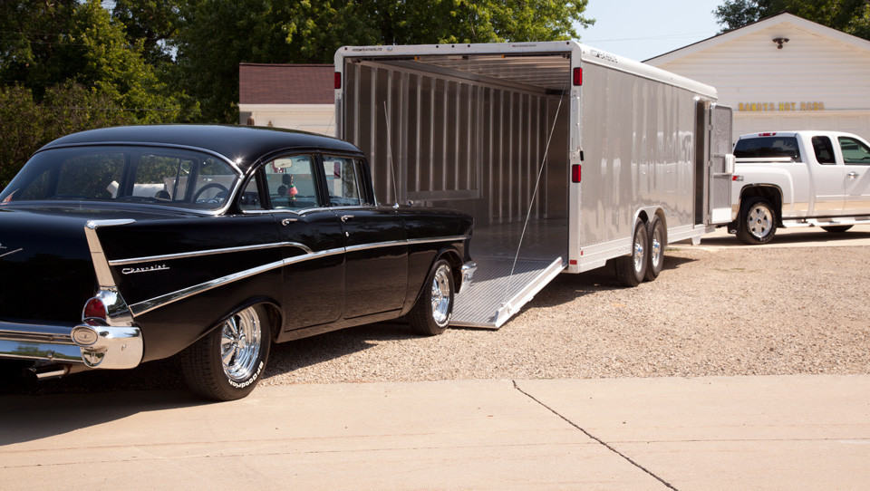 picture of a restomod going into a car trailer