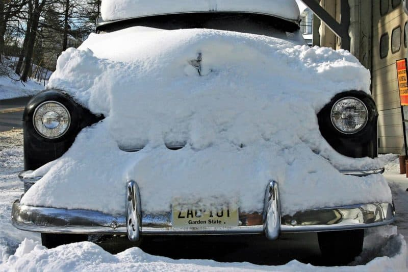This is a picture of a classic car being stored in the winter